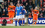 St Johnstone v Dundee United...11.02.12.. SPL.Johnny Russell celebrates as Jody Morris looks on dejected.Picture by Graeme Hart..Copyright Perthshire Picture Agency.Tel: 01738 623350  Mobile: 07990 594431