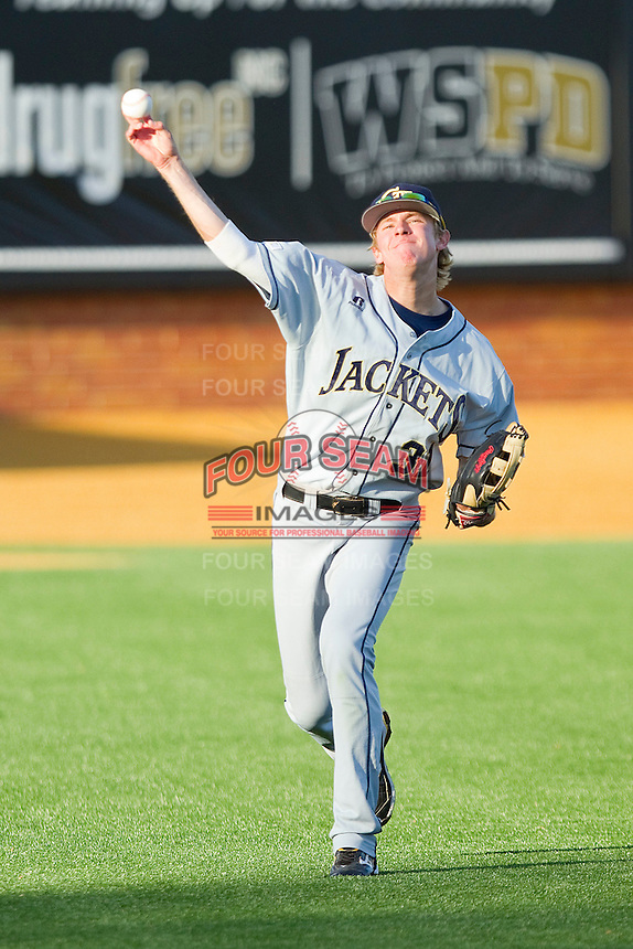 Left fielder Sam Dove #31 of the Georgia Tech Yellow Jackets warms up between innings during the game against the Wake Forest Demon Deacons at Gene Hooks Field on April 16, 2011 in Winston-Salem, North Carolina.  Photo by Brian Westerholt / Four Seam Images
