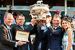 ELMONT, NY - JUNE 11: Owner Bobby Flay (R) and the Creator connections hold up the trophy after they won the Belmont Stakes on Belmont Stakes Dayy at Belmont Park on June 11, 2016 in Elmont, New York. (Photo by Sue Kawczynski/Eclipse Sportswire/Getty Images)