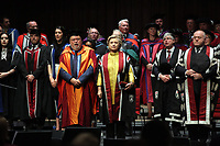 Pictured: Hillary Clinton (C) stands while the welsh anthem is being sung at Swansea University Bay Campus. Saturday 14 October 2017<br />