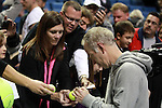 USA's John McEnroe signs autographs for fans after winning the match during the HSBC Tennis Cup series at First Niagara Center in Buffalo, NY on October 22, 2011
