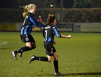 20131213 - VARSENARE , BELGIUM : Brugge's Ingrid De Rycke (right) pictured celebrating her goal and lead for Brugge (1-0) with jumping Silke Demeyere (left) during the female soccer match between Club Brugge Vrouwen and PEC Zwolle Ladies , of  matchday 14  in the BENELEAGUE competition. Friday 13th December 2013. PHOTO DAVID CATRY
