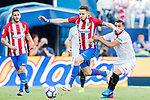 Saul Niguez Esclapez of Atletico de Madrid battles for the ball with Gabriel Mercado of Sevilla FC during their La Liga match between Atletico de Madrid and Sevilla FC at the Estadio Vicente Calderon on 19 March 2017 in Madrid, Spain. Photo by Diego Gonzalez Souto / Power Sport Images