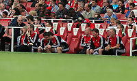 Pictured: Swansea bench, Alan Curtis (R) and Colin Pascoe (2nd R) with other coaching staff. Saturday 10 September 2011<br />