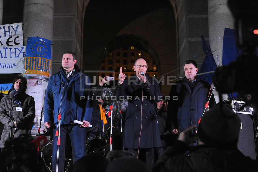 Leaders of opposition parties (left to right) Vitaliy Klitchko, Arseniy Yathsenuk, Oleg Tyagnibok give speech on the Independence sqare few hours before assault.  People that have been dispersed regather in the nearby Mykhailiv monastery to continue the  protest.