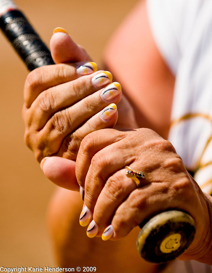 Linda Baziluik, of the Golden Girls softball team from VA, shows her team colored nails during the Senior Games 2009, at Twin Creeks Sports Complex, in Sunnyvale, Calif., on Monday, August 10, 2009.