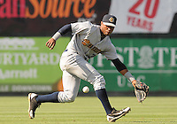 Infielder Angelo Gumbs (21) of the Charleston RiverDogs chases a ground ball in a game against the Greenville Drive on June 3, 2012, at Fluor Field at the West End in Greenville, South Carolina. Charleston won, 5-3. Gumbs is the Yankees' No. 14 prospect, according to Baseball America. (Tom Priddy/Four Seam Images)