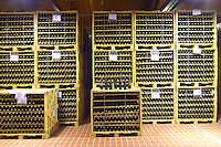 Bottles stored in the cellar. Wire cages. Alpha Estate Winery, Amyndeon, Macedonia, Greece