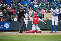 Home plate umpire A.J. Johnson and Cody Stanley (21) of the Memphis Redbirds during the game against the Omaha Storm Chasers in Pacific Coast League action at Werner Park on April 24, 2015 in Papillion, Nebraska.  (Stephen Smith/Four Seam Images)