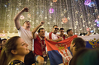 MOSCOW, RUSSIA - June 26, 2018: Russia fans pose for a photograph on Nikolskaya Street during the 2018 FIFA World Cup. The street was a crossroads for foreign soccer fans and local Russians during the World Cup in Russia.