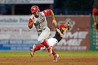 Williamsport Crosscutters third baseman Harold Martinez #6 runs to third as shortstop Vance Albitz #56 makes a diving stop in the background during the second game of a doubleheader against the Batavia Muckdogs at Dwyer Stadium on August 24, 2011 in Batavia, New York.  Albitz turned a double play after the catch as Batavia defeated Williamsport 8-7.  (Mike Janes/Four Seam Images)