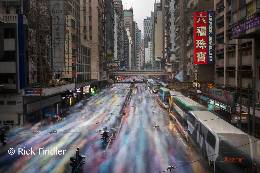 CHINA, Hong Kong: 06 October 2019<br /> A river of pro-democracy demonstrators walk through the streets of Hong Kong Island in protest of China's ever tightening grip on Hong Kong's freedoms. <br /> The leaderless movement embraced the famous Bruce Lee phrase 'Be Water' - adopting a highly agile, mobile and fluid form of protesting causing difficulty for Hong Kong's police force to predict their movements. <br /> This picture was taken using a -10 f-stop ND filter - to allow a long exposure in daylight, with tripod.