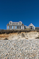 Beach house threatened by ongoing coastal erosion, Stonewall Beach, Chilmark, Martha's Vineyard, Massachusetts, USA