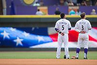Cleuluis Rondon (5) and Jake Peter (3) of the Winston-Salem Dash stand for the National Anthem prior to the game against the Myrtle Beach Pelicans at BB&T Ballpark on April 18, 2015 in Winston-Salem, North Carolina.  The Pelicans defeated the Dash 4-1 in game one of a double-header.  (Brian Westerholt/Four Seam Images)