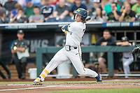 Michigan Wolverines outfielder Jesse Franklin (7) follows through on his swing against the Vanderbilt Commodores during Game 2 of the NCAA College World Series Finals on June 25, 2019 at TD Ameritrade Park in Omaha, Nebraska. Vanderbilt defeated Michigan 4-1. (Andrew Woolley/Four Seam Images)