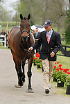 LEXINGTON, KY - APRIL 27: #43 Fernhill Cubalawn and rider Phillip Dutton jog before the vets and grand jury during the first horse inspection for the Rolex Three Day Event on Wednesday April 27, 2016 in Lexington, Kentucky. (Photo by Candice Chavez/Eclipse Sportswire/Getty Images)