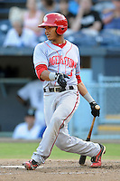 Hagerstown Suns catcher Pedro Severino #4 swings at a pitch during a game against the Asheville Tourists at McCormick Field on May 28, 2013 in Asheville, North Carolina. The Tourists won the game 9-4. (Tony Farlow/Four Seam Images)
