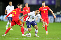 SWANSEA, WALES - NOVEMBER 12: Sebastian Lletget #17 of the United States  wins the ball from Josh Sheehan #21 of Wales during a game between Wales and USMNT at Liberty Stadium on November 12, 2020 in Swansea, Wales.