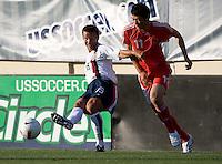 Jesse Marsch slides the ball away from Du Wenhui. The USA defeated China, 4-1, in an international friendly at Spartan Stadium, San Jose, CA on June 2, 2007.