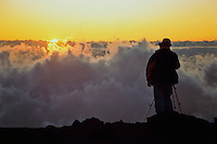 Male photographer watching the sunset at the edge in HALEAKALA NATIONAL PARK on Maui in Hawai USAi