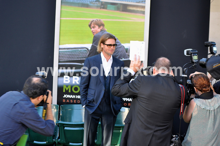 """**ALL ROUND PICTURES FROM SOLARPIX.COM**                                             **SYNDICATION RIGHTS FOR UK, AUSTRALIA, DENMARK, PORTUGAL, S. AFRICA, SPAIN & DUBAI (U.A.E) & ASIA (EXCLUDING JAPAN) ONLY**                                                                                  Caption: Brad Pitt - """"Moneyball"""" Oakland Premiere - Arrivals - Paramount Theatre of the Arts - Oakland, CA, USA                                                                                .This pic:Brad Pitt                                                                                              JOB REF:14013        PHZ       DATE:20.09.2011                                                            **MUST CREDIT SOLARPIX.COM OR DOUBLE FEE WILL BE CHARGED**                                                                      **MUST AGREE FEE BEFORE ONLINE USAGE**                               **CALL US ON: +34 952 811 768 or LOW RATE FROM UK 0844 617 7637**"""