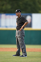 Umpire Mark Fitzgerald handles the calls on the bases during the South Atlantic League game between the Delmarva Shorebirds and the Hickory Crawdads at L.P. Frans Stadium on June 18, 2016 in Hickory, North Carolina.  The Crawdads defeated the Shorebirds 1-0 in game one of a double-header.  (Brian Westerholt/Four Seam Images)