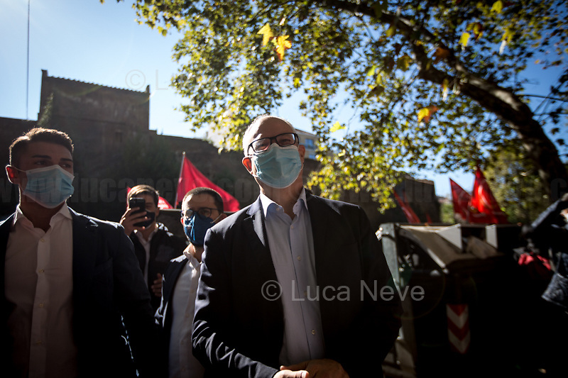 """Roberto Gualtieri (Rome Mayoral Election Candidate, former Minister of Economy and Finance - Democratic Party PD).<br /> <br /> Rome, Italy. 10th October, 2021. Today, thousands of people gathered outside the CGIL (CGIL Confederazione Generale Italiana del Lavoro, Italian General Confederation of Labour, Italian biggest Trade Union) HQ in Corso d'Italia in Rome to attend the Trade Union emergency General Assembly called after the vile attack perpetrated yesterday against the CGIL HQ by the fascist organization forza nuova (for a previous demo: 2.), members of no vax, no pass, no green pass, football supporters, conspiracy theorists, far-right extremists, Covid-19 deniers (negazionisti). The General Secretary of the CGIL, Maurizio Landini, in his today speech stated that what happened yesterday was a """"fascist and squad action"""" against the Workers, the founding values of the Italian Democratic Republic, the principles enshrined in the Constitution born of anti-fascism, the Resistance and the Liberation Struggle. He added that the fascist organizations (Illegal in Italy) need to be immediately dismatled, that this kind of despicable actions against Democracy cannot be tolerated, calling for a national Antifascists demonstration on the 16th October 2021 in Rome.<br /> <br /> Footnotes & Links:<br /> 1. http://cgil.it/ & https://bit.ly/2E1Al5a (Wikipedia)<br /> 2. 24.07.21 - No Green Pass Demo - Far-right, NoGreenPass, NoVax, Covid19 Deniers, Conspiracy Theorists https://lucaneve.photoshelter.com/gallery/24-07-21-No-Green-Pass-Demo-Far-right-NoGreenPass-NoVax-Covid19-Deniers-Conspiracy-Theorists/G0000m5VttrwCq6A/C0000GPpTqAGd2Gg"""