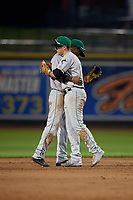 Clinton LumberKings shortstop Marcos Rivera (1) and second baseman Zach Scott (3) hug after a Midwest League game against the Great Lakes Loons on July 19, 2019 at Dow Diamond in Midland, Michigan.  Clinton defeated Great Lakes 3-2.  (Mike Janes/Four Seam Images)