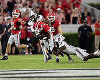 ATHENS, GA - SEPTEMBER 18: Zamir White #3 is tackled by R.J. Roderick #10 and Jaylan Foster #12 before a game between South Carolina Gamecocks and Georgia Bulldogs at Sanford Stadium on September 18, 2021 in Athens, Georgia.