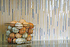 Tatami backsplash shown in Blue Macauba, Crema marfil, Joanna, Sylvia Gold honed and polished mixed