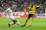 Real Madrid's Lucas Vazquez and Borussia Dortmund Marcel Schmelzer during the UEFA Champions League match between Real Madrid and Borussia Dortmund at Santiago Bernabeu Stadium in Madrid, Spain. December 07, 2016. (ALTERPHOTOS/BorjaB.Hojas)