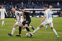 Leon Goretzka (Deutschland Germany) wird von Holmbert Fridjonsson (Island Iceland) und Kari Arnason (Island Iceland) vom Ball getrennt - 25.03.2021: WM-Qualifikationsspiel Deutschland gegen Island, Schauinsland Arena Duisburg