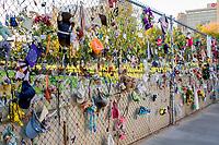 Oklahoma City, Oklahoma, USA.  OKC National Memorial Mementos on Fence.  Toys, Dolls, Clothing of those lost in the blast.