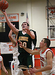 Steven Werth, with Manogue, goes up for a lay-up past Douglas' James Herrick during a boys basketball game between Bishop Manogue and Douglas High in Minden, Nev., on Thursday, Dec. 22, 2011..Photo by Cathleen Allison