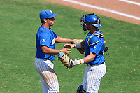 Memphis Tigers pitcher Takoda Metoxen (36) and catcher Hunter Goodman (35) celebrate closing out a game against the East Carolina Pirates on May 25, 2021 at BayCare Ballpark in Clearwater, Florida.  (Mike Janes/Four Seam Images)