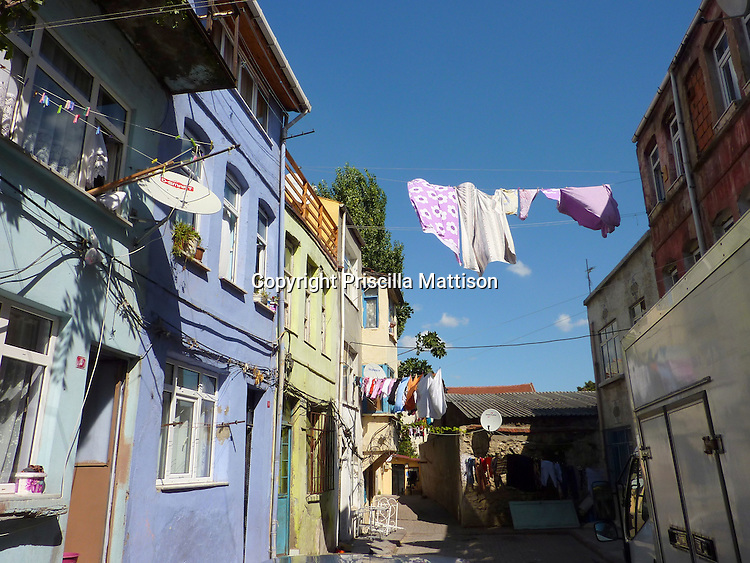 Istanbul, Turkey - September 23, 2009:  Laundry dries on clotheslines over a street.