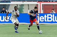 FOXBOROUGH, MA - SEPTEMBER 23: Matt Polster #8 of New England Revolution dribbles as Victor Wanyama #2 of Montreal Impact closes during a game between Montreal Impact and New England Revolution at Gillette Stadium on September 23, 2020 in Foxborough, Massachusetts.