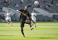 LOS ANGELES, CA - APRIL 17: Diego Palacios #12 of LAFC watching the ball during a game between Austin FC and Los Angeles FC at Banc of California Stadium on April 17, 2021 in Los Angeles, California.
