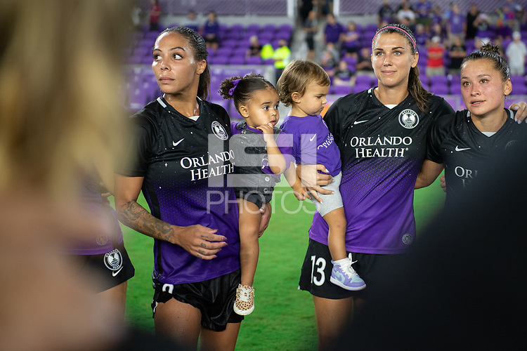 ORLANDO, FL - SEPTEMBER 11: Sydney Leroux #2 and Alex Morgan #13 of the Orlando Pride in the huddle during a game between Racing Louisville FC and Orlando Pride at Exploria Stadium on September 11, 2021 in Orlando, Florida.