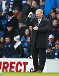 Manager Ally McCoist pumps the air with his fist after Rangers open the scoring