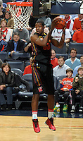 Jan. 27, 2011; Charlottesville, VA, USA; Maryland Terrapins forward Dino Gregory (33) grabs a rebound during the game against the Virginia Cavaliers at the John Paul Jones Arena. Maryland won 66-42. Mandatory Credit: Andrew Shurtleff
