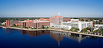 Aerial image of St. Vincents Medical Center shot at low elevation via helicopter over the St. Johns River - southeast to northwest 16x9 format landscape view..