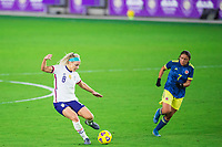 ORLANDO, FL - JANUARY 18: Julie Ertz #8 of the USWNT kicks the ball during a game between Colombia and USWNT at Exploria Stadium on January 18, 2021 in Orlando, Florida.