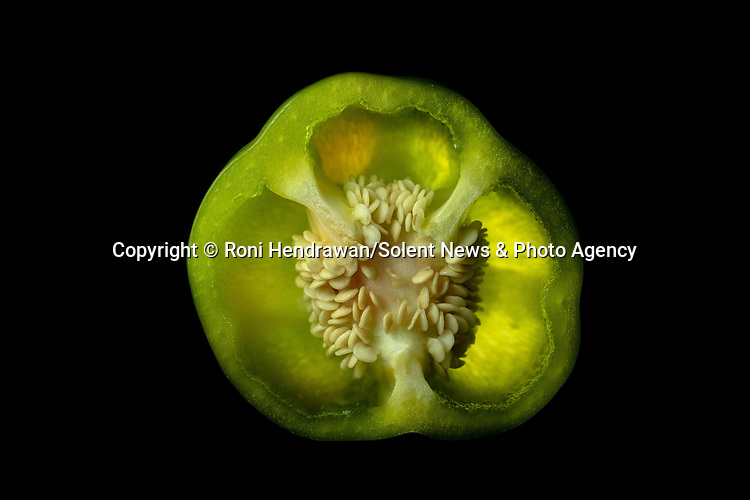 Pictured:  REVEAL:  Bell Pepper<br /> <br /> CAPTURED USING JUST A DESK LAMP AND A CAMERA DURING LOCKDOWN.......Amazing up close photos show fruit and vegetables as you've never seen them before.  Photographer Roni Hendrawan used a special lens to capture the vibrant images of aubergines, sweetcorn, onions, limes, cucumbers, tomatoes and peppers.<br /> <br /> The 29 year old spent three months assembling the produce in lockdown from what he would ordinarily eat before doing the shoot in his kitchen with a macro lens.  SEE OUR COPY FOR DETAILS.<br /> <br /> Please byline: Roni Hendrawan/Solent News<br /> <br /> © Roni Hendrawan/Solent News & Photo Agency<br /> UK +44 (0) 2380 458800