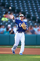 Oklahoma City Dodgers third baseman Buck Britton (4) warmup throw to first during a game against the Fresno Grizzles on June 1, 2015 at Chickasaw Bricktown Ballpark in Oklahoma City, Oklahoma.  Fresno defeated Oklahoma City 14-1.  (Mike Janes/Four Seam Images)