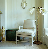 A standard lamp and chair in a corner of the living room
