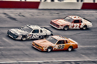 HAMPTON, GA - NOV 3:  Phil Parsons, #66 Chevrolet, Connie Saylor, #99 Chevrolet, and Bobby Allison, #22 Buick, race through a turn during the Atlanta Journal 500 NASCAR Winston Cup race at Atlanta Motor Speedway, November 3, 1985. (Photo by Brian Cleary/www.bcpix.com)