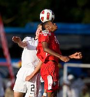 Andrew Souders (2) of the United States goes up for a header with Alfredo Stephens (19) of Panama during the group stage of the CONCACAF Men's Under 17 Championship at Jarrett Park in Montego Bay, Jamaica. The USA defeated Panama, 1-0.