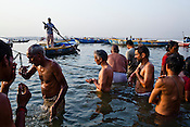 Hindus take a dip in the holy river Ganges in the ancient city of Varanasi in Uttar Pradesh, India. Photograph: Sanjit Das/Panos