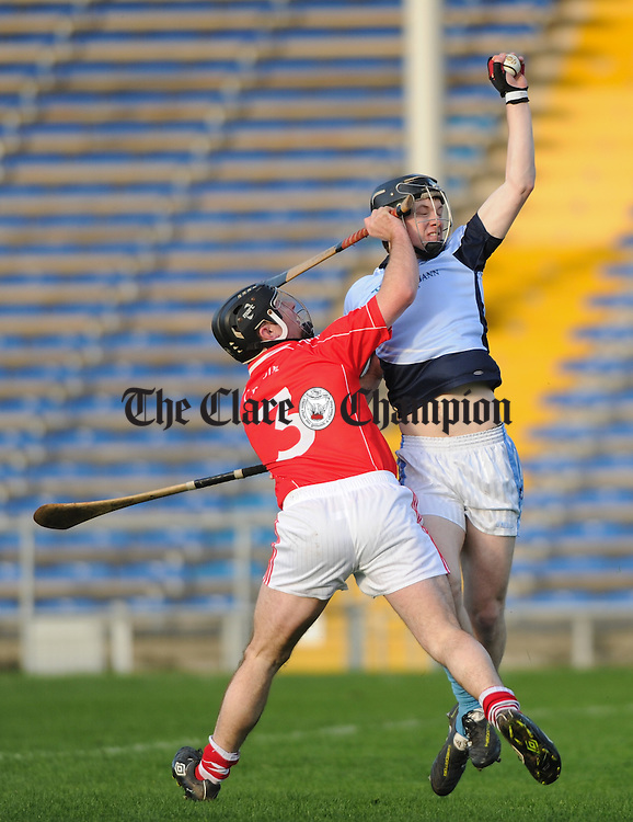 Cronan Dillon of Crusheen in action against Kevin Downes of Na Piarsaigh during their Munster Club final at Thurles. Photograph by John Kelly.